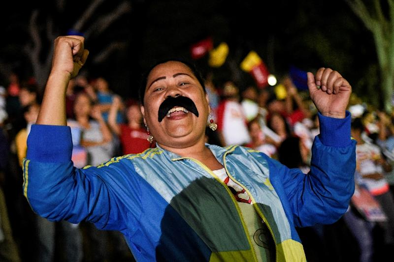 "Supporters of Venezuela's Nicolas Maduro were celebrating his ""knockout"" victory (AFP Photo/Federico PARRA)"