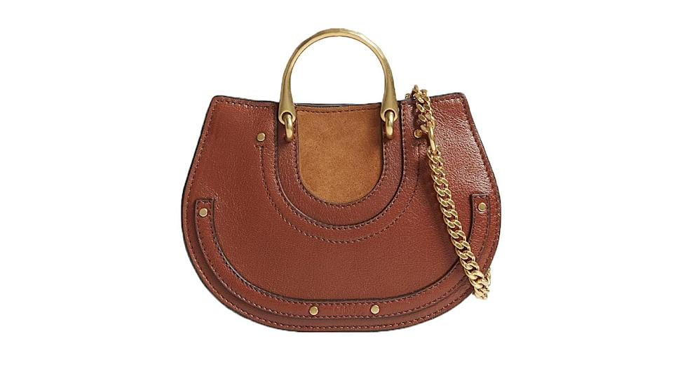 """<p>If you want to invest in a new handbag this season (and are willing to spend a fair bit), this half-moon Chloe bag is our suggestion. It will fit in all of your bits and bobs and will go with any outfit you wear. <a rel=""""nofollow noopener"""" href=""""http://www.selfridges.com/GB/en/cat/chloe-pixie-leather-cross-body-bag_221-3001525-CHC18SS336HGP613/?previewAttribute=Saffron+red"""" target=""""_blank"""" data-ylk=""""slk:Buy here."""" class=""""link rapid-noclick-resp""""><em>Buy here.</em></a> </p>"""