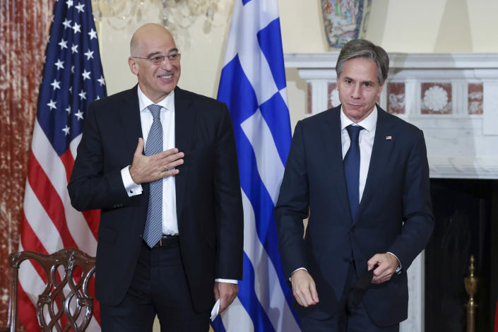 Secretary of State Antony Blinken and Greece's Foreign Minister Nikos Dendias depart after signing the renewal of the U.S.-Greece Mutual Defense Cooperation Agreement at the State Department in Washington, Thursday, Oct. 14, 2021. (Jonathan Ernst/Pool via AP)