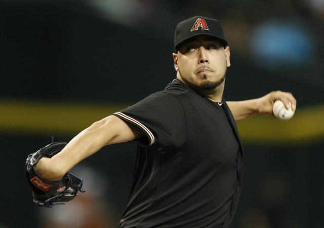 Arizona Diamondbacks starting pitcher Vidal Nuno throws in the first inning of a baseball game against the San Diego Padres, Saturday, Aug. 23, 2014, in Phoenix. (AP Photo/Rick Scuteri)
