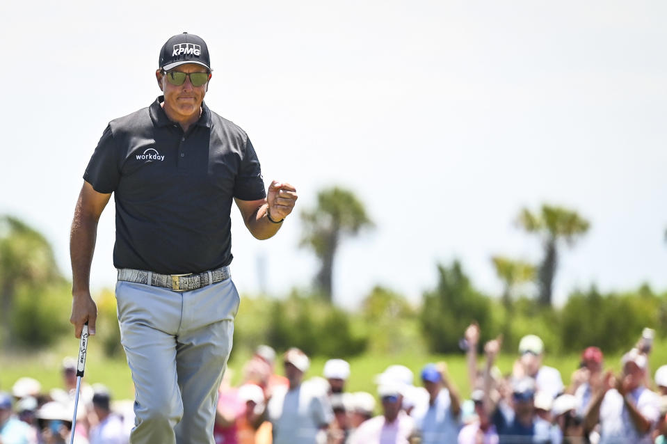 Phil Mickelson smiles and celebrates with a fist pump after making a birdie putt on the ninth hole during the second round of the PGA Championship on The Ocean Course at Kiawah Island Golf Resort in Kiawah Island, South Carolina. (Photo by Keyur Khamar/PGA TOUR via Getty Images)