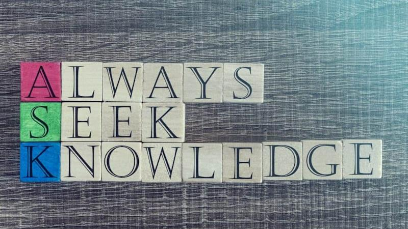 Knowledge concept with quote written on wooden blocks