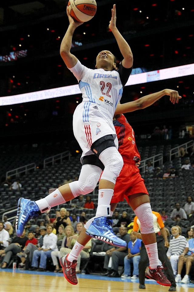 Atlanta Dream's Armintie Herrington (22) shoots against the Washington Mystics in the first quarter of Game 1 of a WNBA basketball Eastern Conference semifinals series, Thursday, Sept. 19, 2013, in Atlanta. (AP Photo/Todd Kirkland)