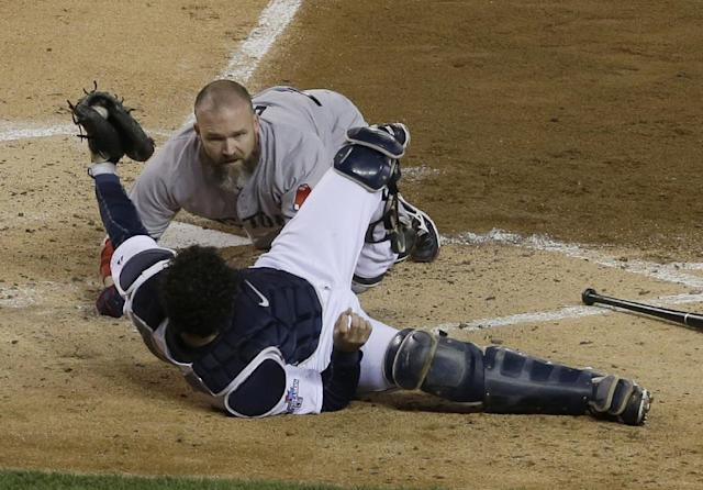 Boston Red Sox's David Ross looks at Detroit Tigers catcher Alex Avila as Ross get out at home on a fielder choice and collides with Avila in the second inning during Game 5 of the American League baseball championship series Thursday, Oct. 17, 2013, in Detroit. (AP Photo/Paul Sancya)