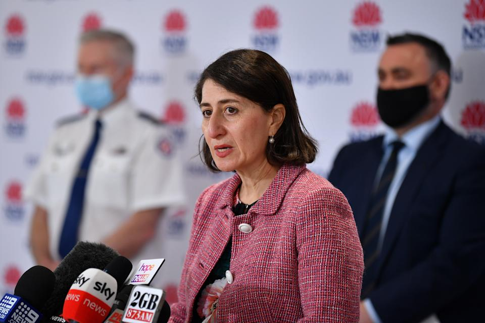 NSW Premier Gladys Berejiklian at the daily Covid press conference wearing a pink jacket.
