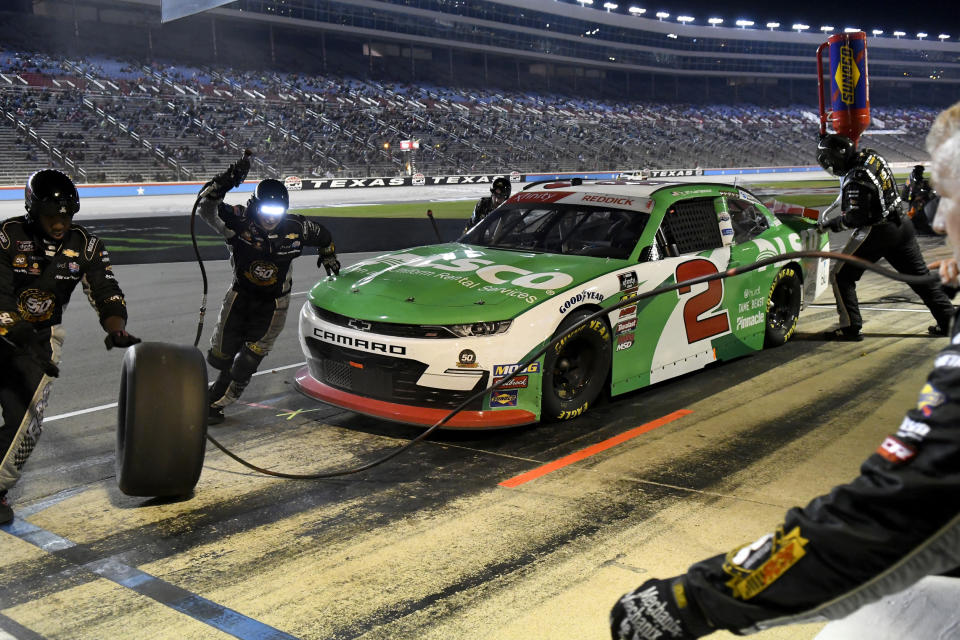 Tyler Reddick makes a pit stop during the NASCAR Xfinity Series auto race at Texas Motor Speedway in Fort Worth, Texas, Saturday, Nov. 2, 2019. (AP Photo/Larry Papke)