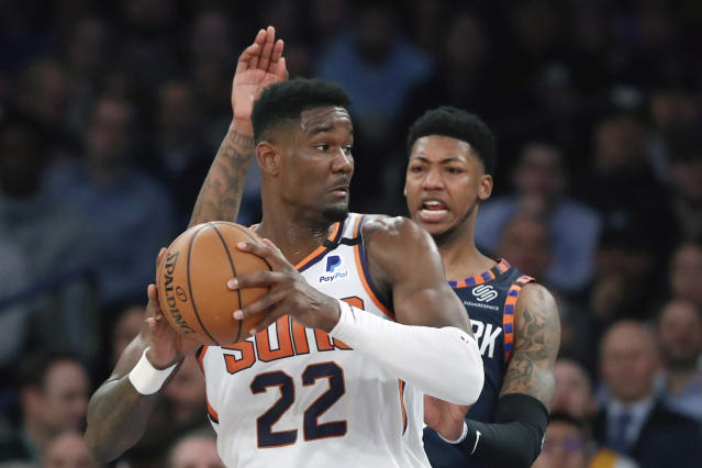 New York Knicks guard Elfrid Payton, right, defends as Phoenix Suns center Deandre Ayton (22) looks to pass during the first quarter of an NBA basketball game in New York, Thursday, Jan. 16, 2020. (AP Photo/Kathy Willens)