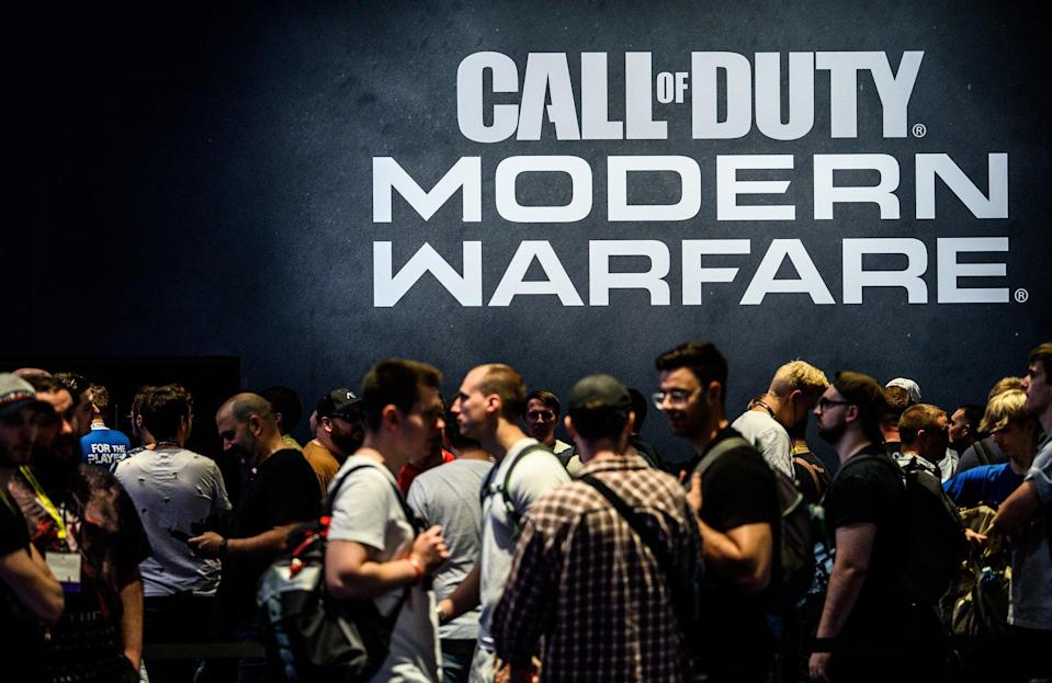 Visitors wait to try out the latest version of Call of Duty Modern Warfare during the press day at the 2019 Gamescom gaming trade fair on August 20, 2019 in Cologne, Germany (Lukas Schulze/Getty Images)