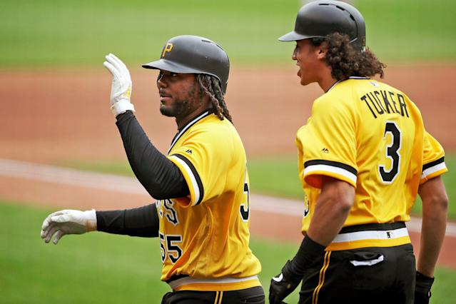 The Pirates' Josh Bell, left, heads back to the dugout with Cole Tucker after hitting a two-run home run off Giants starting pitcher Dereck Rodriguez in the fourth inning Sunday. (AP Photo/Gene J. Puskar)