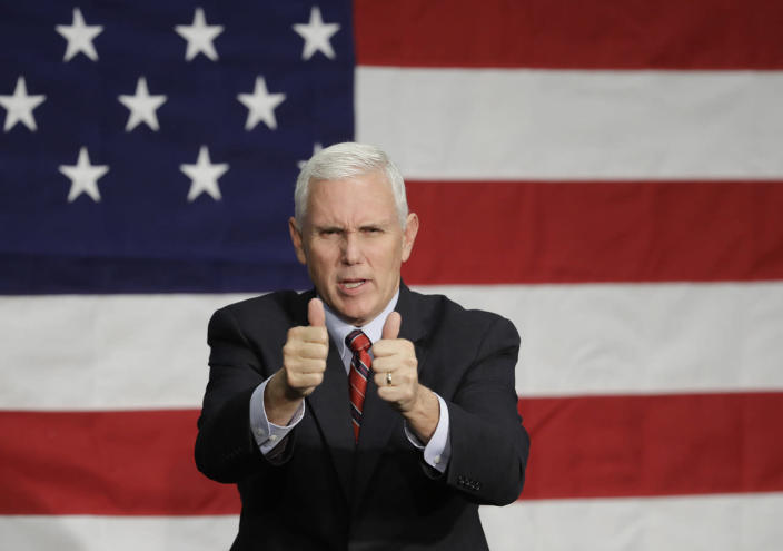 <p>Republican vice presidential candidate, Indiana Gov. Mike Pence reacts following a campaign rally, Sept. 30, 2016, in Fort Wayne, Ind. (Photo: Darron Cummings/AP)</p>