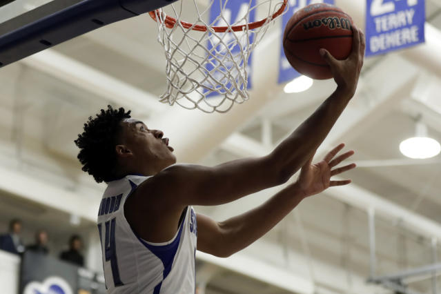 Seton Hall guard Jared Rhoden (14) drives to the basket during the second half of an NCAA college basketball game against Stony Brook on Saturday, Nov. 9, 2019, in South Orange, N.J. Seton Hall won 74-57. (AP Photo/Adam Hunger)