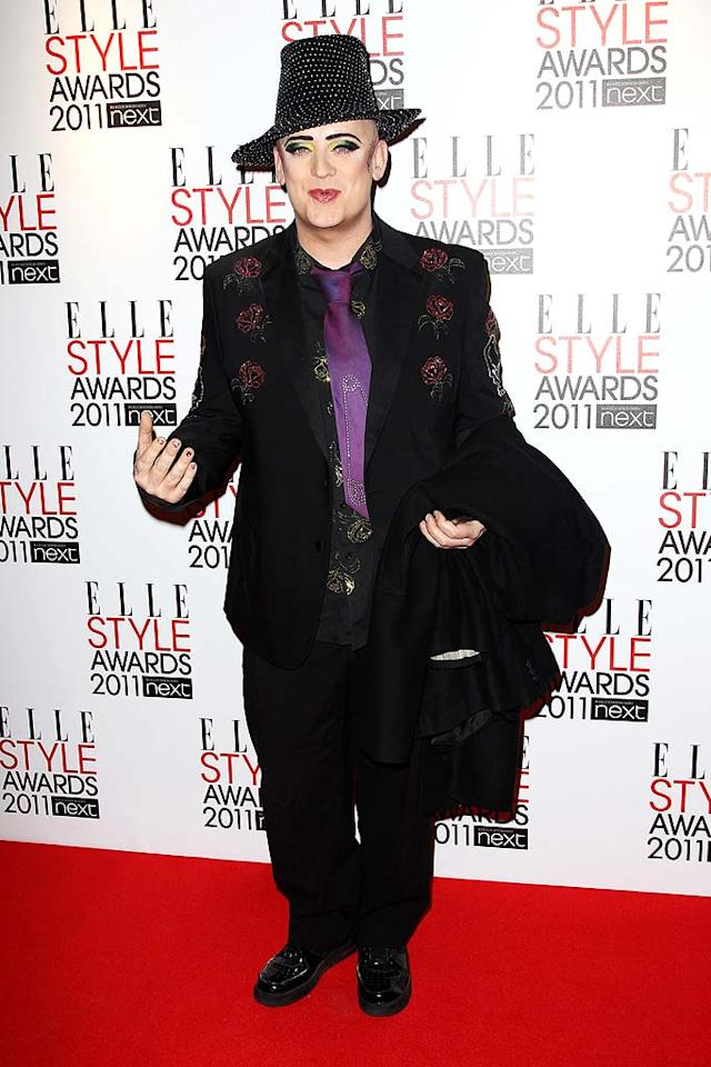"Boy George hit the red carpet sporting a bedazzled shirt, blazer, tie, and hat. The former Culture Club frontman completed his look with lots of makeup! Dave Hogan/Mission Pictures/<a href=""http://www.gettyimages.com/"" target=""new"">GettyImages.com</a> - February 14, 2011"