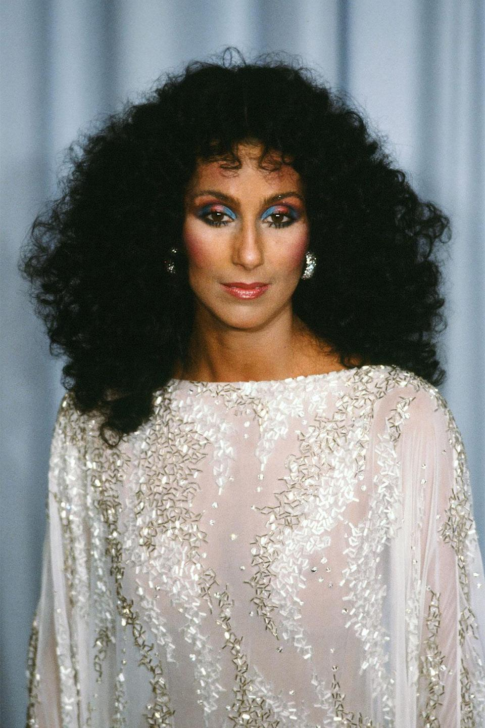 """<p>I lost my """"Train of Thought"""" looking at this understated (well, by Cher's standard) but gorgeous look that Cher rocked at the 1983 Academy Awards. </p>"""
