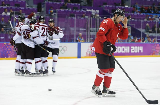 Switzerland defenseman Mathias Seger skates back to the bench after Latvia scored a goal in the first period of a men's ice hockey game at the 2014 Winter Olympics, Tuesday, Feb. 18, 2014, in Sochi, Russia. (AP Photo/Mark Humphrey)