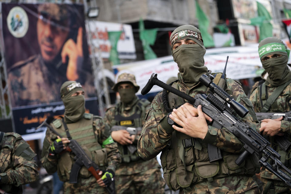 Hamas militants parade through the streets for Bassem Issa, a top Hamas' commander, who was killed by Israeli Defense Force military actions prior to a cease-fire reached after an 11-day war between Gaza's Hamas rulers and Israel, in Gaza City, Saturday, May 22, 2021. (AP Photo/John Minchillo)