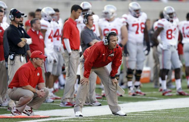 Ohio State coach Urban Meyer, center watches from the sideline during the second half of an NCAA college football game against California, Saturday, Sept. 14, 2013, in Berkeley, Calif. (AP Photo/Ben Margot)