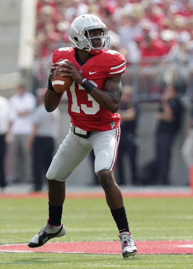 Ohio State quarterback Kenny Guiton drops back to pass against San Diego State during the first quarter of an NCAA college football game Saturday, Sept. 7, 2013, in Columbus, Ohio. (AP Photo/Jay LaPrete)