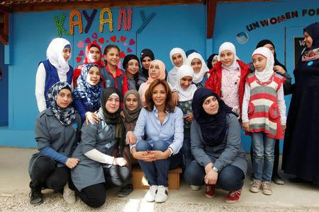 Syrian refugee girls take a photo with Noura Jumblatt, founder of the NGO Kayany Foundation, at a school for Syrian refugee girls, built by the foundation in Bar Elias