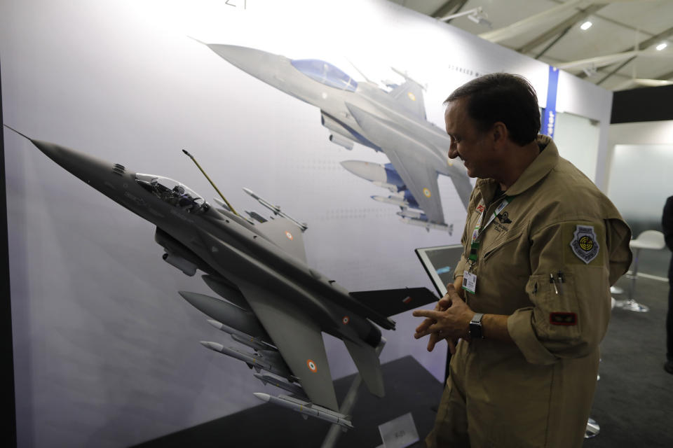 FILE - In this Feb. 5, 2020, file photo, Lockheed Martin's Robert Balserak, Lead Executive, Air Superiority Programs, explains the capabilities of the F-21 at the DefExpo in Lucknow, India. China's government said Monday, Oct. 26, 2020, it will impose sanctions on U.S. military contractors including Boeing Co.'s defense unit and Lockheed Martin Corp. for supplying weapons to rival Taiwan, stepping up a feud with Washington over security and Beijing's strategic ambitions. (AP Photo/Rajesh Kumar Singh, File)