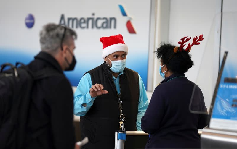 Airline workers in Christmas themed headwear at Ronald Reagan Washington National Airport, in Arlington, Virginia