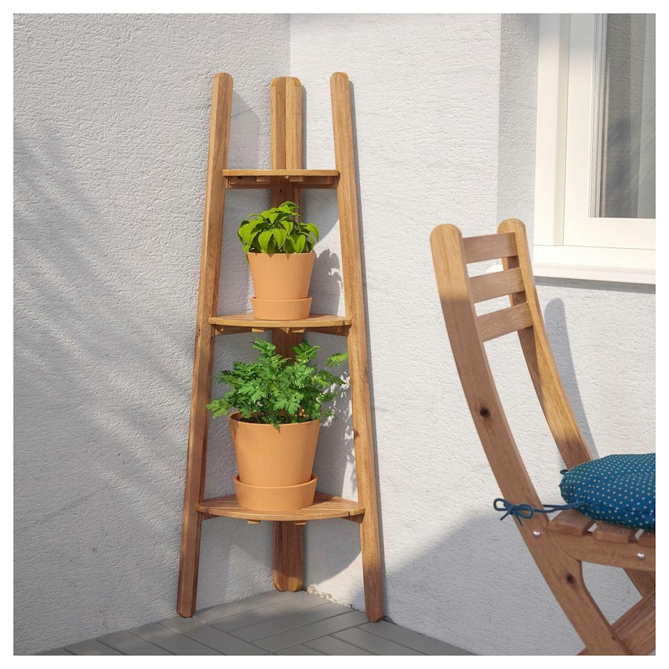 """<p><strong>IKEA</strong></p><p>ikea.com</p><p><strong>$24.99</strong></p><p><a href=""""https://go.redirectingat.com?id=74968X1596630&url=https%3A%2F%2Fwww.ikea.com%2Fus%2Fen%2Fcatalog%2Fproducts%2F10258669%2F&sref=https%3A%2F%2Fwww.goodhousekeeping.com%2Fhome%2Fgardening%2Fadvice%2Fg495%2Fsmall-garden-ideas%2F"""" rel=""""nofollow noopener"""" target=""""_blank"""" data-ylk=""""slk:Shop Now"""" class=""""link rapid-noclick-resp"""">Shop Now</a></p><p>Easily stack pots of herbs or flowers with this wooden plant stand that tucks neatly into the corner. </p>"""