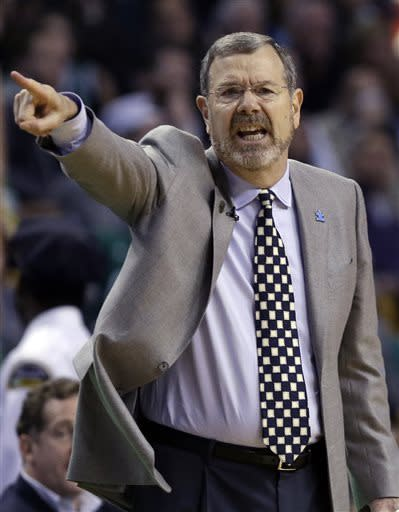 Brooklyn Nets head coach P.J. Carlesimo instructs from the bench during the second quarter of an NBA basketball game against the Boston Celtics in Boston, Wednesday, April 10, 2013. (AP Photo/Elise Amendola)