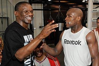 Floyd Mayweather Sr. (left) says his son Floyd Jr. (right) had mental distractions before the first Maidana fight.