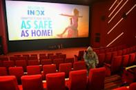 With India's virus cases surging past seven million, Mumbai -- the home of Bollywood -- is putting off re-opening cinemas for the time being