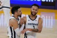 Memphis Grizzlies guard Dillon Brooks, left, and forward Kyle Anderson congratulate each other during a timeout in the first half of the team's NBA basketball game against the Los Angeles Lakers on Friday, Feb. 12, 2021, in Los Angeles. (AP Photo/Mark J. Terrill)