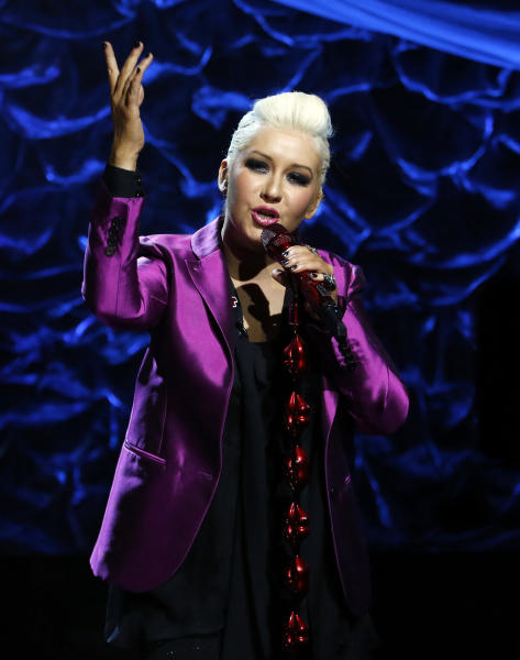 "In this photo provided by NBC, Christina Aguilera, a Staten Island native, performs during ""Hurricane Sandy: Coming Together"" Friday, Nov. 2, 2012, in New York. Hosted by Matt Lauer, the event is heavy on stars identified with New Jersey and the New York metropolitan area, which took the brunt of this week's deadly storm. (AP Photo/NBC, Heidi Gutman)"