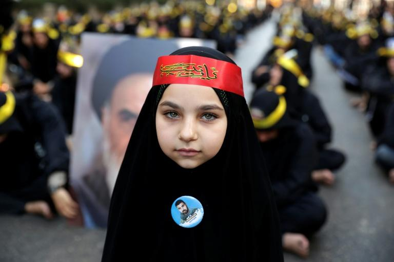 A black-clad young girl is pictured as she takes part with supporters of the Lebanese Shiite Hezbollah movement in a mourning procession on Ashura, in a suburb of Beirut (AFP Photo/ANWAR AMRO)