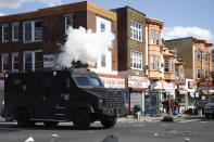FILE - In this May 31, 2020 file photo, police deploy tear gas to disperse a crowd during a protest in Philadelphia over the death of George Floyd. Floyd died May 25, 2020 after he was pinned at the neck by a white Minneapolis police officer. (AP Photo/Matt Rourke, File)