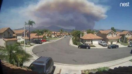 A still frame taken from a timelapse video sourced from social media dated August 6, 2018 shows the Holy Fire as seen from Rancho Santa Magarita, California, U.S. ARTHUR WHITING/via REUTERS