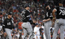 Chicago White Sox manager Tony La Russa (22) makes his way to the mound to remove starting pitcher Dallas Keuchel, second from right, during the third inning of a baseball game against the Houston Astros, Sunday, June 20, 2021, in Houston. (AP Photo/Eric Christian Smith)