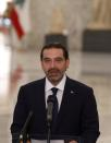 Lebanese Sunni leader Saad al-Hariri, talks to the media after being named Lebanon's new prime minister at the presidential palace in Baabda