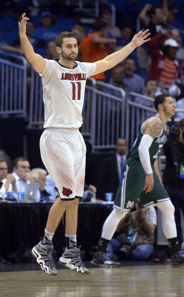 Louisville forward Luke Hancock (11) raises his arms after he hit a 3-pointer late in the second half against Manhattan in a second-round game in the NCAA men's college basketball tournament Thursday, March 20, 2014, in Orlando, Fla. Louisville defeated Manhattan 71-64. (AP Photo/Phelan M. Ebenhack)