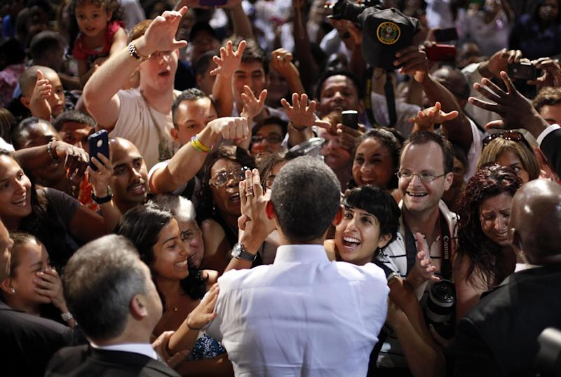 President Barack Obama greets supporter at a campaign event at Rollins College, Thursday, Aug. 2, 2012, in Orlando, Fla. Obama is campaigning in Florida and Northern Virginia today. (AP Photo/Pablo Martinez Monsivais)