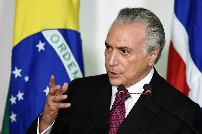 "Dilma Rousseff was left reeling by indications in a leaked letter that her vice president Michel Temer (pictured), leader of the PMDB, could withdraw his support because he felt she had shown ""absolute lack of confidence"" in him (AFP Photo/Evaristo Sa)"
