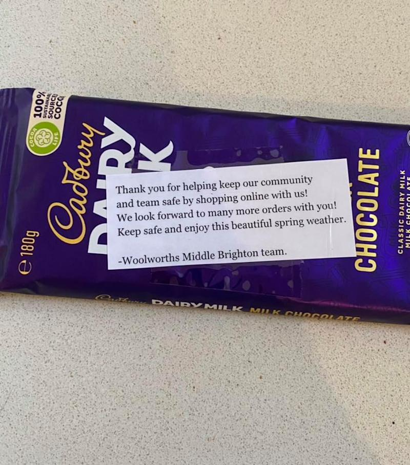 The chocolate block pictured with the note from Woolworths staff.