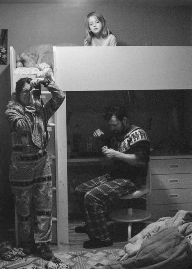 Lindsey Irene uses a mirror to capture an image of her family hunkered down at home.
