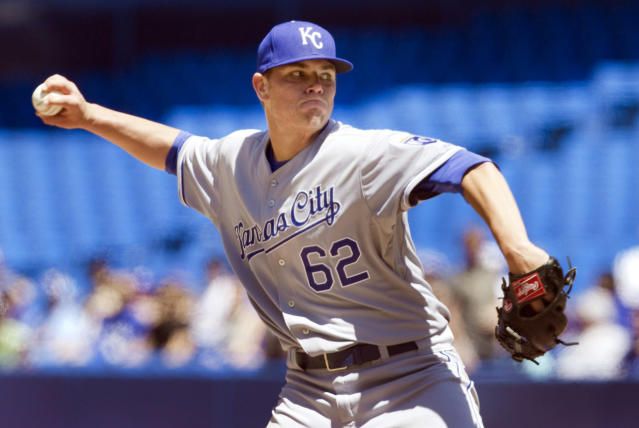 Kansas City Royals starting pitcher Aaron Brooks throws against the Toronto Blue Jays during first inning of a baseball game in Toronto, Saturday, May 31, 2014. (AP Photo/The Canadian Press, Fred Thornhill)