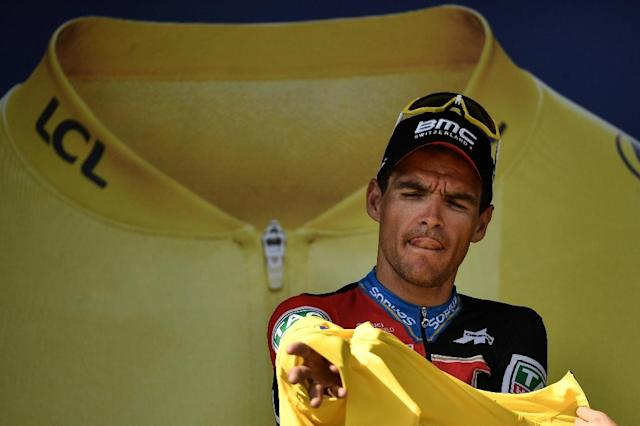 Greg Van Avermaet puts on the overall leader's yellow jersey again (AFP Photo/Marco BERTORELLO)