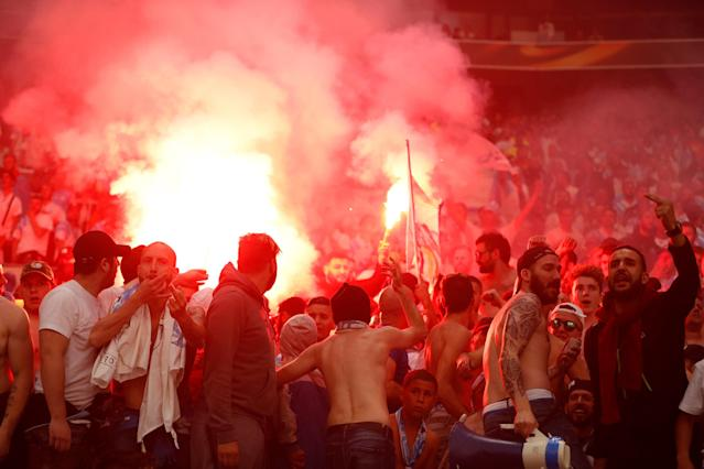 Soccer Football - Europa League Final - Olympique de Marseille vs Atletico Madrid - Groupama Stadium, Lyon, France - May 16, 2018 Marseille fans set off flares in the stands REUTERS/John Sibley