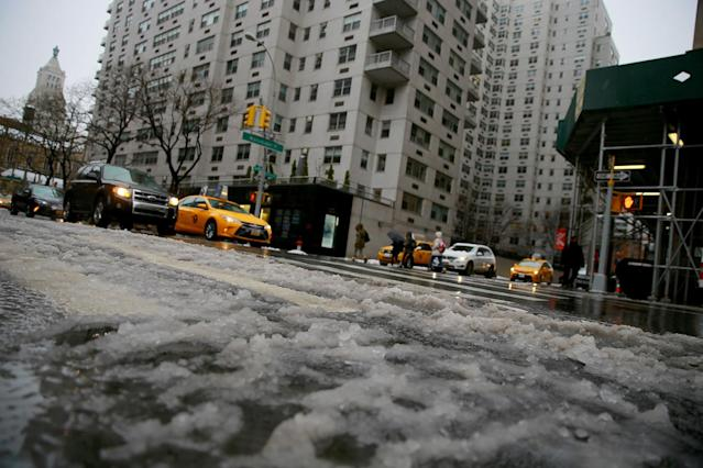 <p>The streets are layered in icy mixture of snow and rain as traffic moves down Broadway in New York City, March 7, 2018. (Photo: Gordon Donovan/Yahoo News) </p>