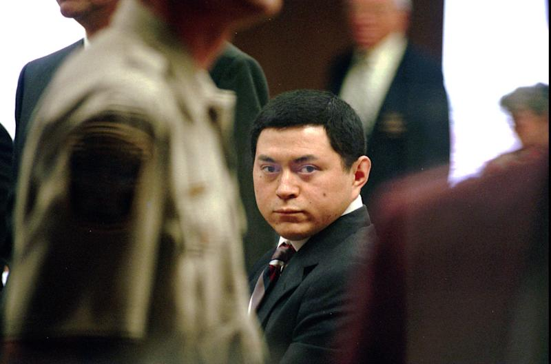 FILE - In a Wednesday, Aug. 17, 1994 file photo, capital murder suspect Michael Blair watches as potential juriors enter a Midland, Texas, courtroom. When Blair was sent to death row for the infamous murder of 7-year-old Ashley Estell, he insisted he never killed anyone. More than a decade later, genetic testing showed he was telling the truth. But during those long years behind bars, Blair confessed to raping two other children, a crime for which he's serving multiple life sentences. Blair has made an unlikely demand, asking the state for nearly $1 million as compensation for being wrongfully convicted. His request has gone all the way to the Texas Supreme Court and is forcing a re-examination of laws designed to offer exonerated inmates a new start. (AP Photo/Plano Star Courier, Ian Halpern, File) NO SALES