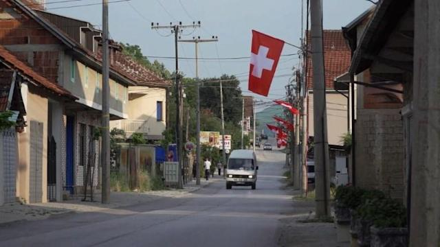 Fans in Kosovo celebrate the Swiss team's 2-1 victory over Serbia in the World Cup Group Stage. Two of Switzerland's players were born in Kosovo, including goal scorer Xherdan Shaqiri, while another Granit Xhaka was born in Basel to a Kosovar family.