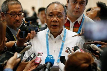Philippine presidential spokesperson Ernesto Abella talks to the media after he read a statement from the Philippine government at the ASEAN Summit in Vientiane