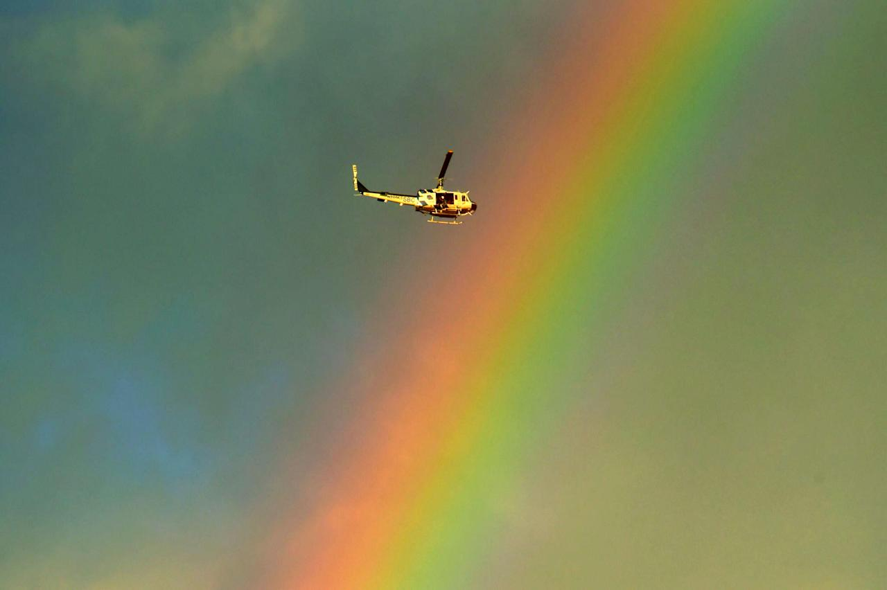 <p>A Santa Barbara County Air Support Unit helicopter under a rainbow while on a rescue mission following deadly mudflow (AP) </p>