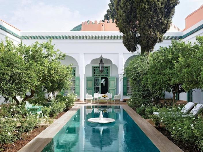 The central courtyard's tiled pool was deepened for swimming at an 18th-century Marrakech holiday home.