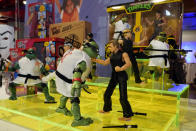 Teenage Mutant Ninja Turtles vs Cobra Kai, by Playmates, are displayed at the TTPM Holiday Showcase, in New York, Thursday, Sept. 23, 2021. With three months until Christmas, toy companies are racing to get their toys onto store shelves as they face a severe supply network crunch. Toy makers are feverishly trying to find containers to ship their goods while searching for new alternative routes and ports. (AP Photo/Richard Drew)